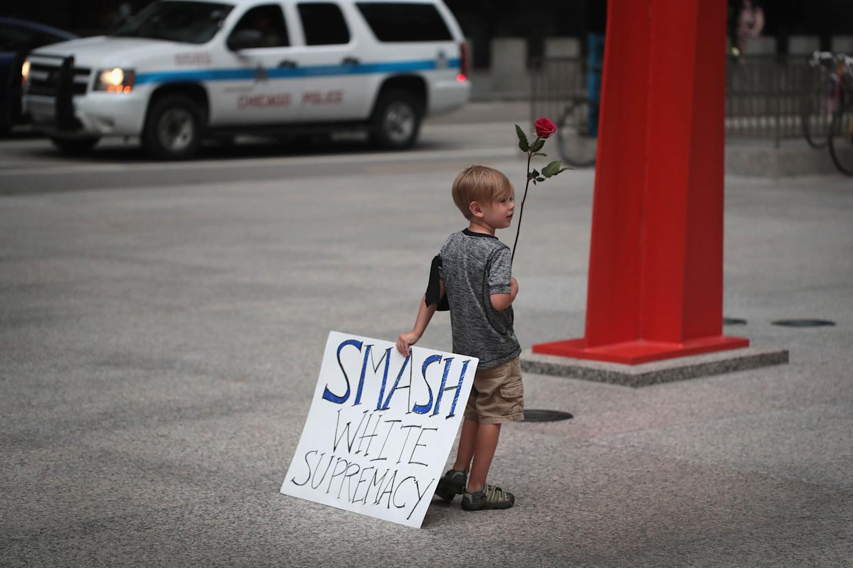Four-year-old Leo Griffin leaves an Aug. 13 Chicago protest thatmourned the victims of the white supremacistrally in Charlottesville, Virginia,the day before.