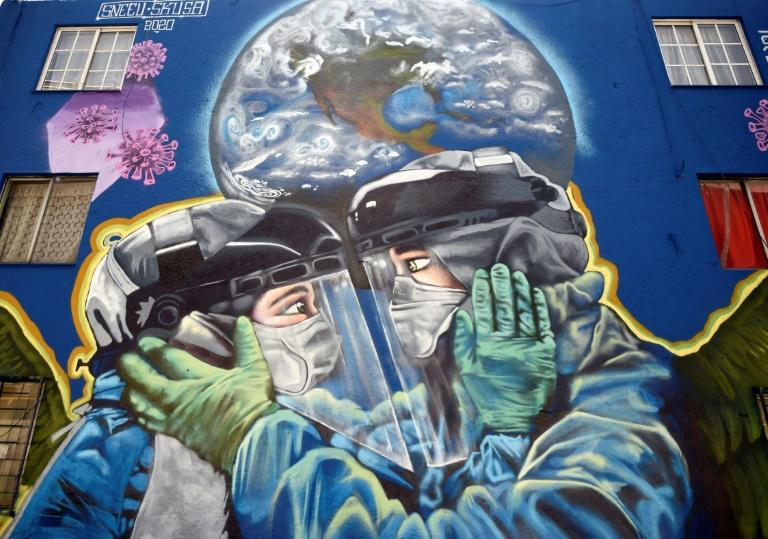 The pandemic is gaining ground in Latin America -- including in Mexico, where this mural was painted (AFP Photo/ALFREDO ESTRELLA)