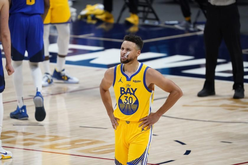 Golden State Warriors guard Stephen Curry (30) in the second half of a game late Thursday, Jan. 14, 2021, in Denver