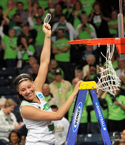 Notre Dame forward Natalie Achonwa holds a piece of the net after their NCAA women's college basketball tournament regional final game at the Purcell Pavilion in South Bend, Ind Monday March 31, 2014. Notre Dame beat Baylor, 88-69. (AP Photo/Joe Raymond)
