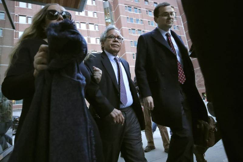 Insys Therapeutics founder John Kapoor, center, departs federal court Thursday, Jan. 23, 2020, in Boston, after he was sentenced to 5 1/2 years in prison for orchestrating a bribery and kickback scheme prosecutors said helped fuel the opioid crisis. He was found guilty the previous May of racketeering and conspiracy in a scheme where millions of dollars in bribes were paid to doctors across the United States to prescribe the company's highly addictive oral fentanyl spray, known as Subsys. (AP Photo/Charles Krupa)