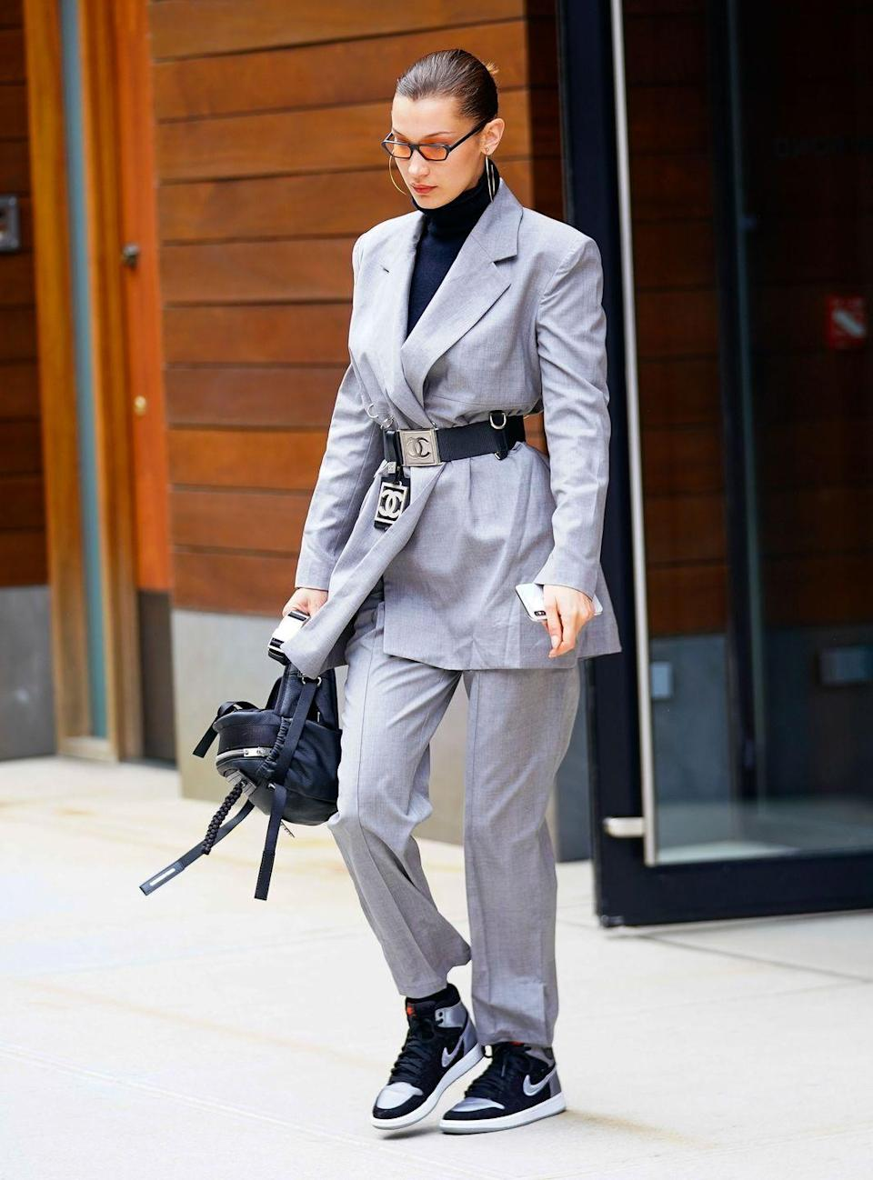 <p>The model wore a suit, cinched with a Chanel belt out and about in New York.</p>