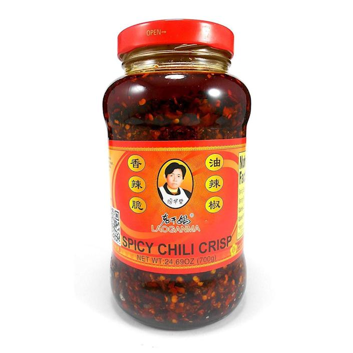 """<p><strong>Lao Gan Ma</strong></p><p>amazon.com</p><p><strong>$13.79</strong></p><p><a href=""""https://www.amazon.com/dp/B06XYTSGDP?tag=syn-yahoo-20&ascsubtag=%5Bartid%7C2141.g.27760489%5Bsrc%7Cyahoo-us"""" rel=""""nofollow noopener"""" target=""""_blank"""" data-ylk=""""slk:Shop Now"""" class=""""link rapid-noclick-resp"""">Shop Now</a></p><p>Not so much spicy as it is crunchy and garlicky, this chili crisp is divine paired with takeout, avocado toast, and tofu. And even if he's already acquainted with Lao Gan Ma, he'll get a kick out of this restaurant-sized jar.</p>"""
