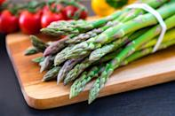 """<p>You may be tempted to just leave the bunch of asparagus in the thin plastic bag you carried it home in. But asparagus spears take some tending to in order to keep them fresh. <a href=""""https://www.theactivetimes.com/healthy-living/gardening-tips?referrer=yahoo&category=beauty_food&include_utm=1&utm_medium=referral&utm_source=yahoo&utm_campaign=feed"""" rel=""""nofollow noopener"""" target=""""_blank"""" data-ylk=""""slk:Like you would the stems of flowers"""" class=""""link rapid-noclick-resp"""">Like you would the stems of flowers</a>, place the bottom of asparagus spears in a shallow pool of water. Stand the spears upright and cover the tips of the spears loosely with a plastic bag to protect them from contamination from other fridge odors. If you'd rather save that level of effort for a real bouquet, you can opt for an easier method. Simply wrap your bundle of spears in a damp paper towel. This will help the spears to retain moisture and keep from drying out too quickly due to refrigerator air.</p>"""