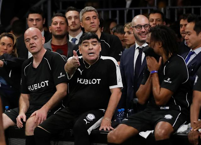 Soccer Football - Hublot Match of Friendship - Congress Center, Basel, Switzerland - March 21, 2018 Diego Maradona and members of Team Diego Maradona, FIFA president Gianni Infantino, Hernan Crespo and Christian Karembeu during the match REUTERS/Arnd Wiegmann