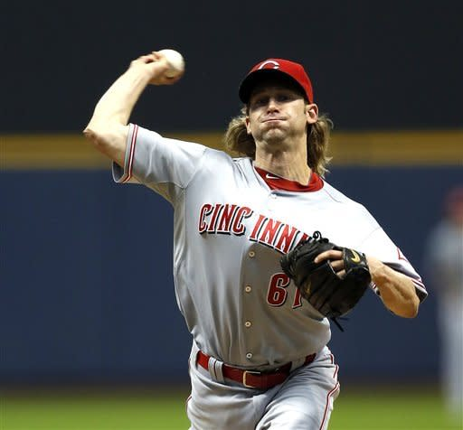 Bronson Arroyo of the Cincinnati Reds prepares to release a pitch during the first inning of a baseball game Monday, May 7, 2012, in Milwaukee. (AP PhotoTom Lynn)