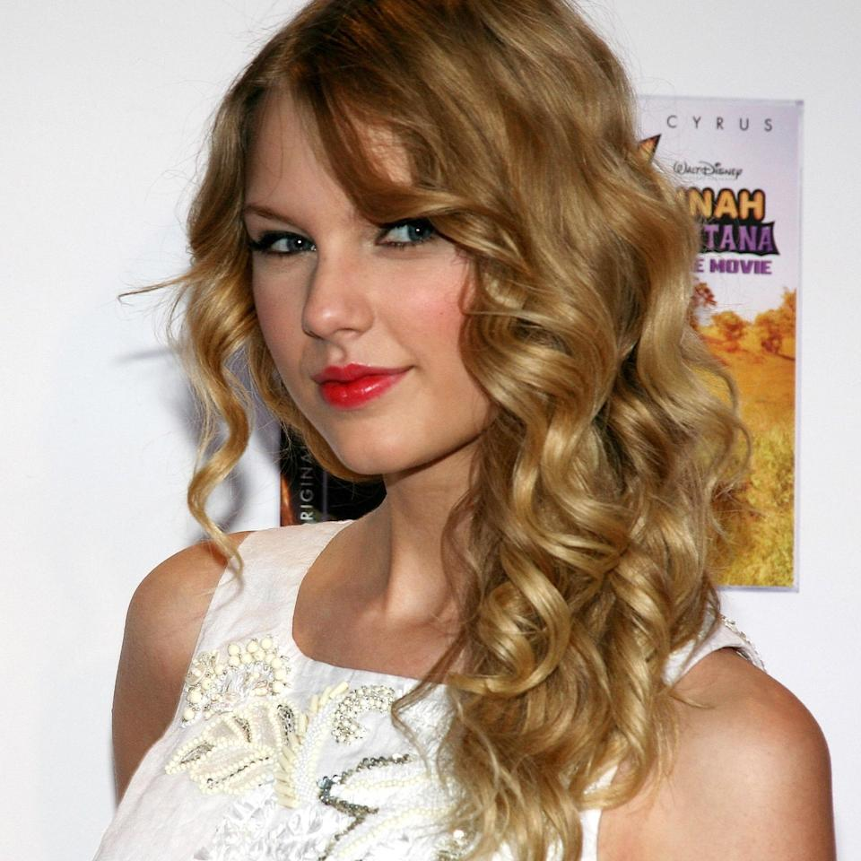 """Taylor Swift has gone through many hair variations but who can forget the long curls back from her original <em>Fearless</em> days? """"This haircut has blended layers to give the curls some movement,"""" says Potempa. """"It's perfect for someone who has a natural wave pattern that may be slightly uneven. Sometimes, cutting a long blended bang allows for the natural wave to come to life."""" If your waves are falling flat, use a curling iron to give it an extra bit of oomph."""
