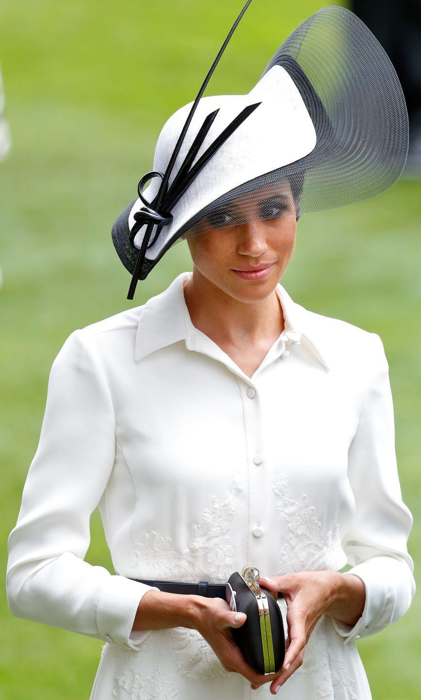 "<p>That's not to say that Kate's the only Windsor who knows how to accessorize at Ascot, though. <a href=""https://www.townandcountrymag.com/society/tradition/a21614131/meghan-markle-royal-ascot-2018-kate-middleton-comparison/"" rel=""nofollow noopener"" target=""_blank"" data-ylk=""slk:For her first-ever appearance at the annual royal event, Meghan"" class=""link rapid-noclick-resp"">For her first-ever appearance at the annual royal event, Meghan</a> chose a sculptural Philip Treacy hat.<br></p>"