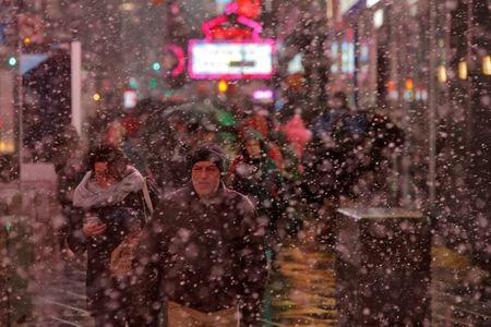 Nor'easter slams East Coast with heavy rain, snow