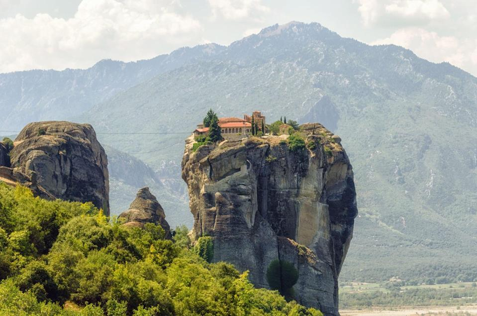 <p>Monasteries precariously perched on top of sandstone rock pillars make Meteora a must-see sight. </p>