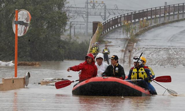 """<span class=""""element-image__caption"""">Rescue workers in Nagano prefecture after Typhoon Hagibis struck Japan.</span> <span class=""""element-image__credit"""">Photograph: Kim Kyung-Hoon/Reuters</span>"""
