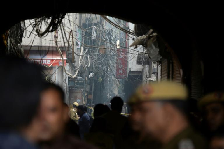 The blaze broke out in the early hours in the city's old quarter, whose narrow and congested lanes are lined with many small manufacturing and storage units (AFP Photo/Sajjad  HUSSAIN                     )