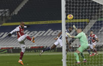 Arsenal's Alexandre Lacazette scores his sides 4th goal of the game during the English Premier League soccer match between West Bromwich Albion and Arsenal at the Hawthorns in Birmingham, England, Saturday, Jan. 2, 2021. (Michael Regan/ Pool via AP)