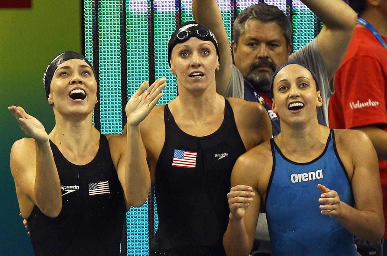 SHANGHAI, CHINA - JULY 30:  (L-R) Natalie Coughlin, Dana Vollmer and Rebecca Soni of the United States cheer on Melissa Franklin on the way to winning the gold medal in the Women's 4x100m Medley Relay during Day Fifteen of the 14th FINA World Championships at the Oriental Sports Center on July 30, 2011 in Shanghai, China.  (Photo by Quinn Rooney/Getty Images)
