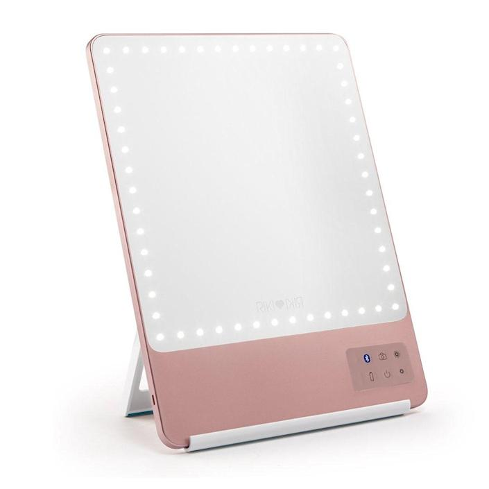 """You don't have to be an expert selfie taker to appreciate this renowned portable LED vanity mirror. After all, it doubles as a streaming device with Bluetooth capabilities and has five dimming stages so that you never have to do your hair or makeup under unflattering fluorescents again. If you are looking to up your selfie game, you'll love the magnetic phone holder. $195, Amazon. <a href=""""https://www.amazon.com/GLAMCOR-Skinny-Function-Magnification-Attachment/dp/B089VLHHP2"""" rel=""""nofollow noopener"""" target=""""_blank"""" data-ylk=""""slk:Get it now!"""" class=""""link rapid-noclick-resp"""">Get it now!</a>"""