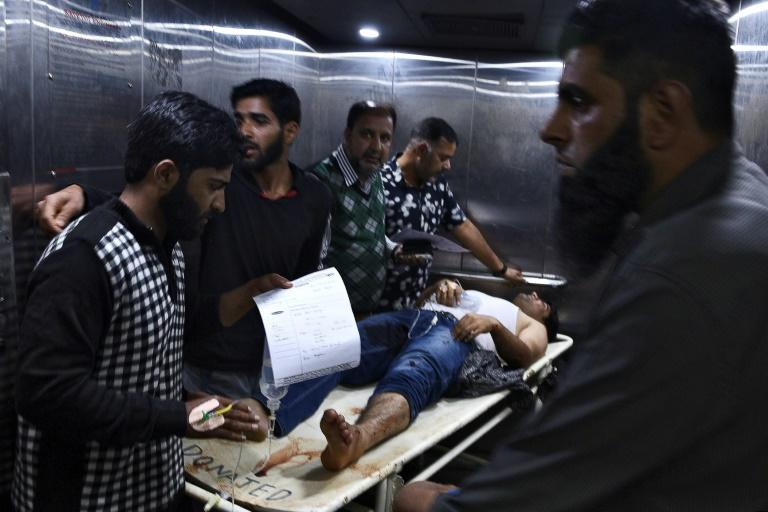An injured man is rushed to hospital after the grenade attack in Srinagar that police blamed on militants and which highlighted tensions over New Delhi's actions in Kashmir (AFP Photo/HABIB NAQASH)