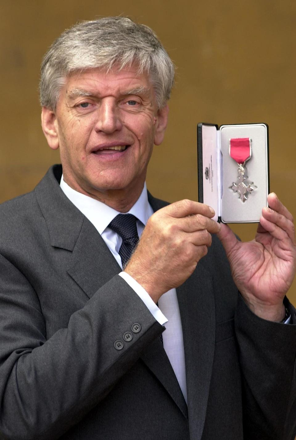Dave Prowse received an MBE for services to charity and road safety from Queen Elizabeth II in 2000 (Photo: PA)