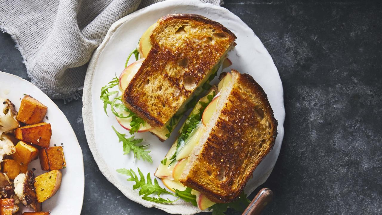 """<p><strong>Try this recipe:</strong> <a href=""""https://www.health.com/recipes/apple-havarti-grilled-cheese-sandwiches"""">Apple Havarti Grilled Cheese Sandwiches</a></p> <p>Grilled cheese isn't just for kids anymore! Adding Havarti and arugula to this lunchtime classic lends it a touch of maturity.</p> <p><strong>Ingredients:</strong> Dijon mustard, multigrain bread, Honeycrisp apple, Havarti cheese, unsalted butter, arugula</p> <p><strong>Calories:</strong> 409</p>"""
