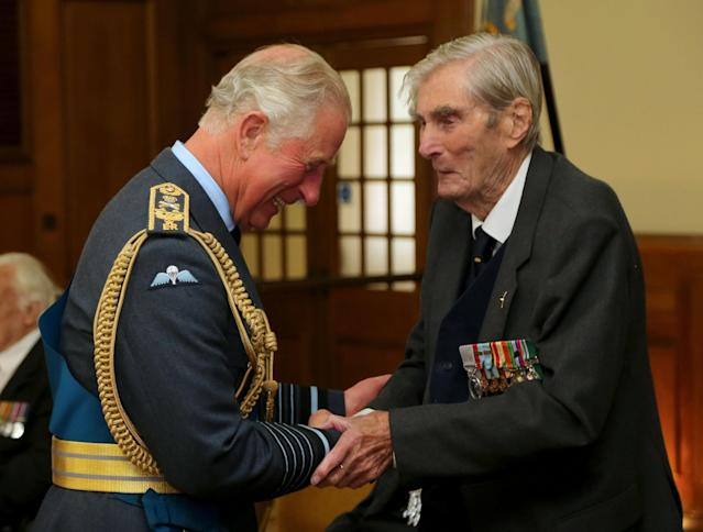 The Prince of Wales talking to Battle of Britain veteran Wing Commander Paul Farnes (PA)