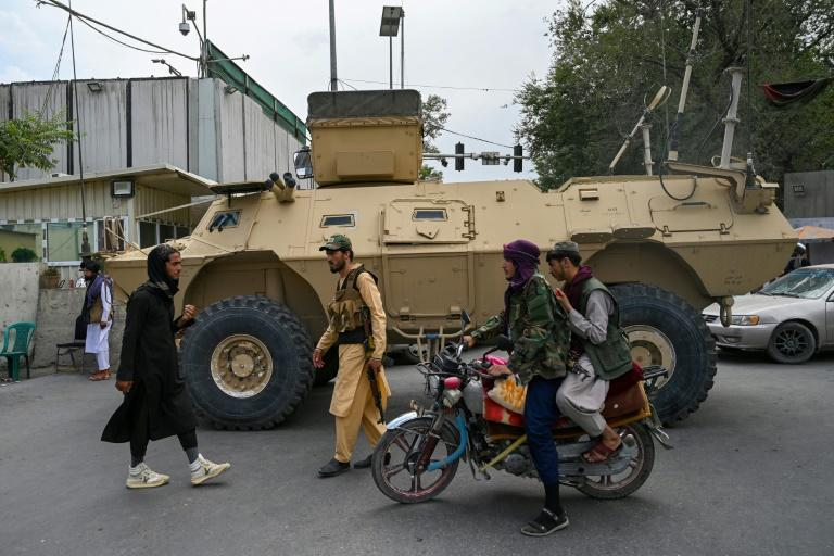 Taliban patrol Kabul in a US-made armored vehicle captured from the Afghan security forces