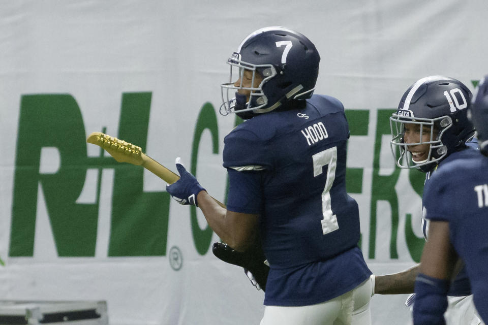 Georgia Southern wide receiver Khaleb Hood (7) holds a guitar as he celebrates a touchdown against Louisiana Tech during the first half of the New Orleans Bowl NCAA college football game in New Orleans, Wednesday, Dec. 23, 2020. (AP Photo/Matthew Hinton)