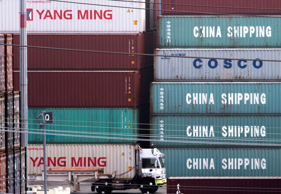 A truck passes by China Shipping containers at the Port of Los Angeles, after new tariffs on Chinese imports was imposed by President Trump, in Long Beach, California on September 1, 2019. - Washington moved ahead Sunday with new tariffs on Chinese imports as it stepped up a high-pressure campaign aimed at coercing Beijing to sign a new trade deal even amid fears of a further slowing of US and world growth. (Photo by Mark RALSTON / AFP)        (Photo credit should read MARK RALSTON/AFP/Getty Images)