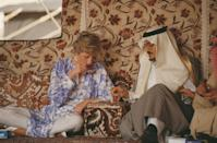 <p>Princess Diana savors a cup of tea during a picnic in the desert near Riyadh, Saudi Arabia.</p>