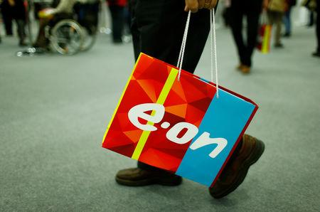 A shareholder carries a bag with the logo of E.ON during the company's annual shareholders meeting in Essen