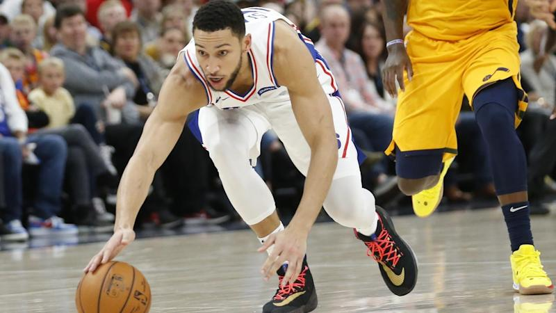 Philadelphia 76ers guard Ben Simmons reaches for the ball before getting injured against the Jazz