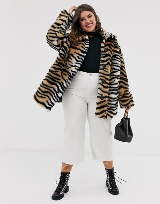 """<p>Curl up in this cute <a href=""""https://www.popsugar.com/buy/ASOS-Design-Tiger-Faux-Fur-Button-Through-Coat-490042?p_name=ASOS%20Design%20Tiger%20Faux%20Fur%20Button%20Through%20Coat&retailer=asos.com&pid=490042&price=119&evar1=fab%3Aus&evar9=46708574&evar98=https%3A%2F%2Fwww.popsugar.com%2Fphoto-gallery%2F46708574%2Fimage%2F46708603%2FASOS-Design-Tiger-Faux-Fur-Button-Through-Coat&list1=shopping%2Cfall%20fashion%2Ccoats%2Cfall%2Ccurve%2Ccurve%20fashion&prop13=api&pdata=1"""" rel=""""nofollow"""" data-shoppable-link=""""1"""" target=""""_blank"""" class=""""ga-track"""" data-ga-category=""""Related"""" data-ga-label=""""https://www.asos.com/us/asos-curve/asos-design-curve-tiger-faux-fur-button-through-coat/prd/11989533?clr=multi&amp;colourWayId=16419649&amp;SearchQuery=&amp;cid=9577"""" data-ga-action=""""In-Line Links"""">ASOS Design Tiger Faux Fur Button Through Coat</a> ($119). </p> <p><br></p> <p><br></p> <p>Buy now!<br></p> <p><br></p> <p><br></p>"""