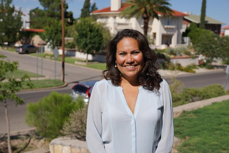 Veronica Escobar, 47, stands in her front yard in El Paso, Texas. She is hoping to be the first Latina Texas has ever elected to Congress. (Laura Bassett)