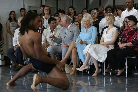 Britain's Prince Charles and Camilla, Duchess of Cornwall, with Cuban dancer Carlos Acosta and his wife Charlotte Acosta watch a dance performance at Acosta's dance studio in Havana, Cuba, March 25, 2019. REUTERS/Fernando Medina NO RESALES. NO ARCHIVE