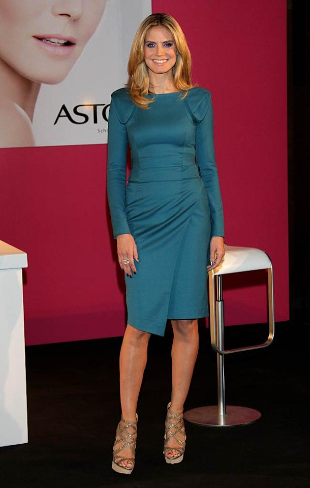 "We love that ""Project Runway"" hostess with the mostest Heidi Klum isn't afraid of color, and we especially love the teal Rachel Roy frock (and Christian Louboutin ""Balota"" sandals) she wore while attending an Astor press conference in Germany. <a href=""http://www.splashnewsonline.com"" target=""new"">Splash News</a> - January 27, 2011"