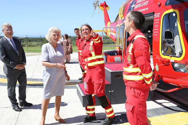 The Duchess of Cornwall speaks with air crew during a visit to Cornwall Air Ambulance Trust's base in Newquay: PA