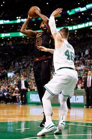 May 23, 2018; Boston, MA, USA; Cleveland Cavaliers center Tristan Thompson (13) attempts a basket in front of Boston Celtics center Aron Baynes (46) during the first quarter of game five of the Eastern conference finals of the 2018 NBA Playoffs at TD Garden. Mandatory Credit: Greg M. Cooper-USA TODAY Sports