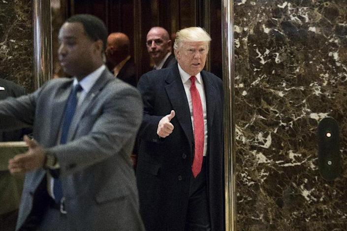 Donald Trump arrives in the lobby of Trump Tower in New York to speak to members of the media, Dec. 6, 2016. (Photo: Andrew Harnik/AP)