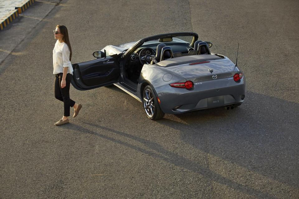 This photo provided by Mazda shows the Mazda MX-5, one of the least expensive but most enjoyable convertibles on the market. (Courtesy of Mazda North American Operations via AP)