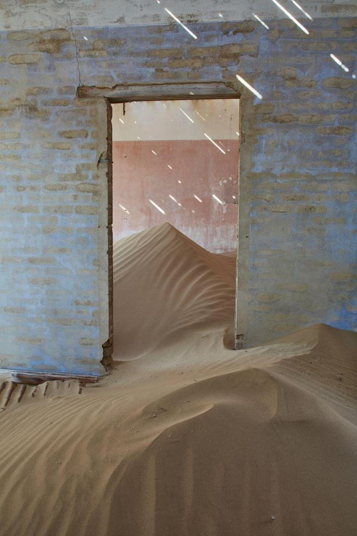 <p>This town was founded in the Namib desert in 1908 when a man found a diamond in the area, but was abandoned in 1954 after resources were exhausted. The homes that were left are now filled high with sand—a strange, yet striking, sight to behold.</p>