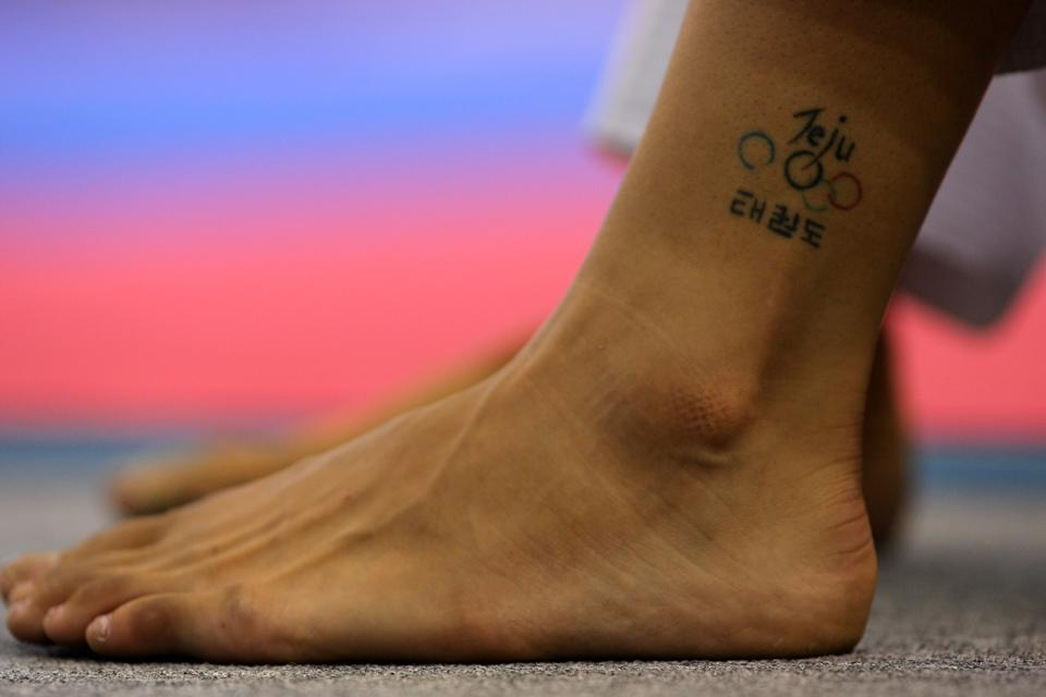 Sarah Stevenson's Olympic tattoo can be seen during Team GB Taekwondo training at the Macau Pavilion on July 31, 2008 in Macau, China. (Photo by Stu Forster/Getty Images)