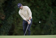 Patrick Cantlay chips in for a birdie on the 12th hole during the first round of the Genesis Invitational golf tournament at Riviera Country Club, Thursday, Feb. 18, 2021, in the Pacific Palisades area of Los Angeles. (AP Photo/Ryan Kang)