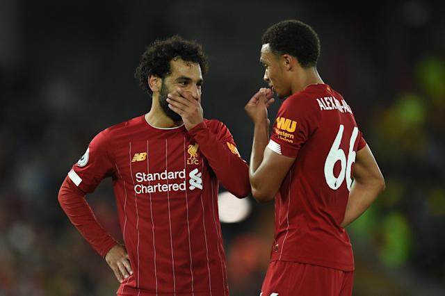 Liverpool's Egyptian midfielder Mohamed Salah (L) discusses with Liverpool's English defender Trent Alexander-Arnold during the English Premier League football match between Liverpool and Norwich City at Anfield in Liverpool, north west England on August 9, 2019. (Photo by Oli SCARFF / AFP) / RESTRICTED TO EDITORIAL USE. No use with unauthorized audio, video, data, fixture lists, club/league logos or 'live' services. Online in-match use limited to 120 images. An additional 40 images may be used in extra time. No video emulation. Social media in-match use limited to 120 images. An additional 40 images may be used in extra time. No use in betting publications, games or single club/league/player publications. / (Photo credit should read OLI SCARFF/AFP/Getty Images)