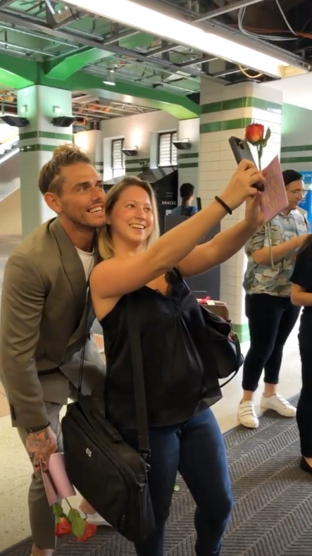 Bachelor star Timm Hanly poses for a selfie with a fan on Valentine's Day