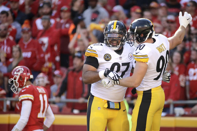 Steelers defensive end Cameron Heyward (97) and outside linebacker T.J. Watt celebrate during their win over the Chiefs. (AP)