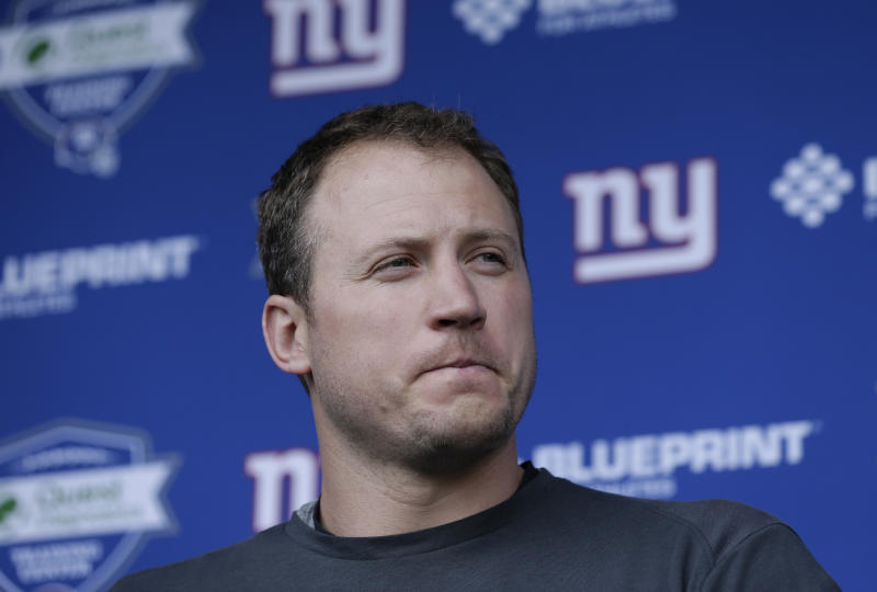 Nate Solder speaks to reporters in front of a New York Giants backdrop.