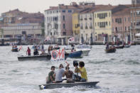 """""""No Big Ships"""" activists stage a protest as the MSC Orchestra cruise ship leaves Venice, Italy, Saturday, June 5, 2021. The 92,409-ton, 16-deck MSC Orchestra cruise ship, the first cruise ship leaving Venice since the pandemic is set to depart Saturday amid protests by activists demanding that the enormous ships be permanently rerouted out the fragile lagoon, especially Giudecca Canal through the city's historic center, due to environmental and safety risks. The ship passed two groups of protesters: pro-cruise advocates whose jobs depend on the industry as well as protesters who have been campaigning for years to get cruise ships out of the lagoon. The cruiser passed two groups of protesters: pro-cruise advocates whose jobs depend on the industry as well as protesters who have been campaigning for years to get cruise ships out of the lagoon. (AP Photo/Antonio Calanni)"""