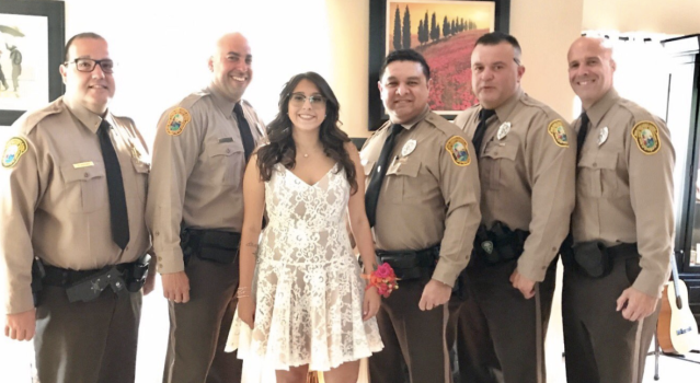 Officers from the Miami-Dade Police Department escorted the daughter of a fallen officer to prom. (Photo: Twitter/MiamiDadePD)