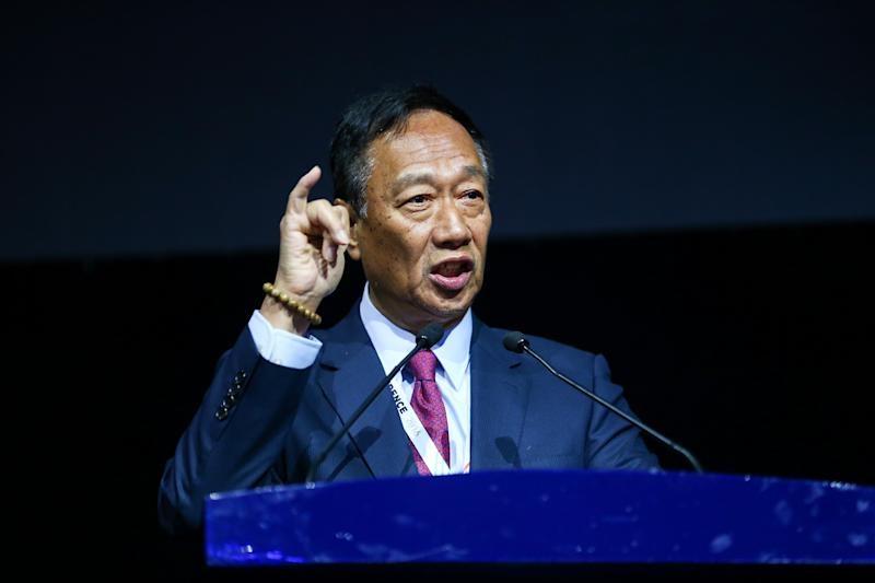 """HANGZHOU, CHINA - OCTOBER 13: Terry Gou, founder and chairman of Foxconn, makes speech during opening ceremony of the Computing Conference 2016 at Hangzhou Yunqi Cloud Town International Expo Centre on October 13, 2016 in Hangzhou, Zhejiang Province of China. The Computing Conference 2016 is held on October 13-16 with over 450 speech topics. Compared with its 2015 predecessor, Computing Conference 2016 reaches more Chinese cities and provides more useful information to perfectly embody the concept of """"Computing Without Borders"""". (Photo by VCG/VCG via Getty Images)"""