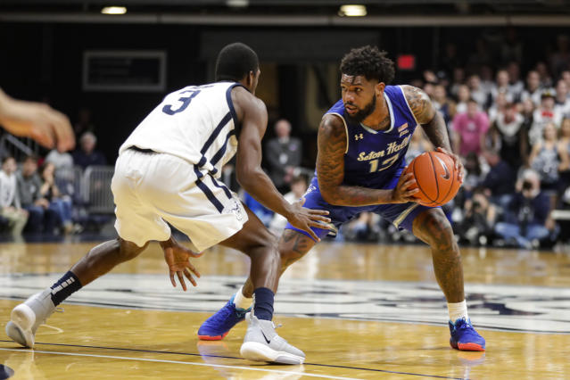 Seton Hall guard Myles Powell (13) looks to drive on Butler guard Kamar Baldwin (3) in the second half of an NCAA college basketball game in Indianapolis, Wednesday, Jan. 15, 2020. Seton Hall defeated Butler 78-70. (AP Photo/Michael Conroy)