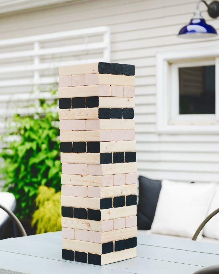 """<p>While most giant Jenga tutorials call for 2"""" by 4"""" boards, these bloggers found that 2"""" by 3"""" boards are the closest match to the scale of the original game. If you already have the right tools at home, this bargain of a project can be completed for just $10. </p><p><strong>Get the tutorial at <a href=""""https://www.yellowbrickhome.com/giant-jenga-with-a-twist/"""" rel=""""nofollow noopener"""" target=""""_blank"""" data-ylk=""""slk:Yellow Brick Home"""" class=""""link rapid-noclick-resp"""">Yellow Brick Home</a>. </strong></p><p><a class=""""link rapid-noclick-resp"""" href=""""https://go.redirectingat.com?id=74968X1596630&url=https%3A%2F%2Fwww.walmart.com%2Fsearch%2F%3Fquery%3Dmiter%2Bsaw&sref=https%3A%2F%2Fwww.thepioneerwoman.com%2Fhome-lifestyle%2Fcrafts-diy%2Fg36687460%2Fbest-outdoor-games%2F"""" rel=""""nofollow noopener"""" target=""""_blank"""" data-ylk=""""slk:SHOP MITER SAWS"""">SHOP MITER SAWS</a></p>"""