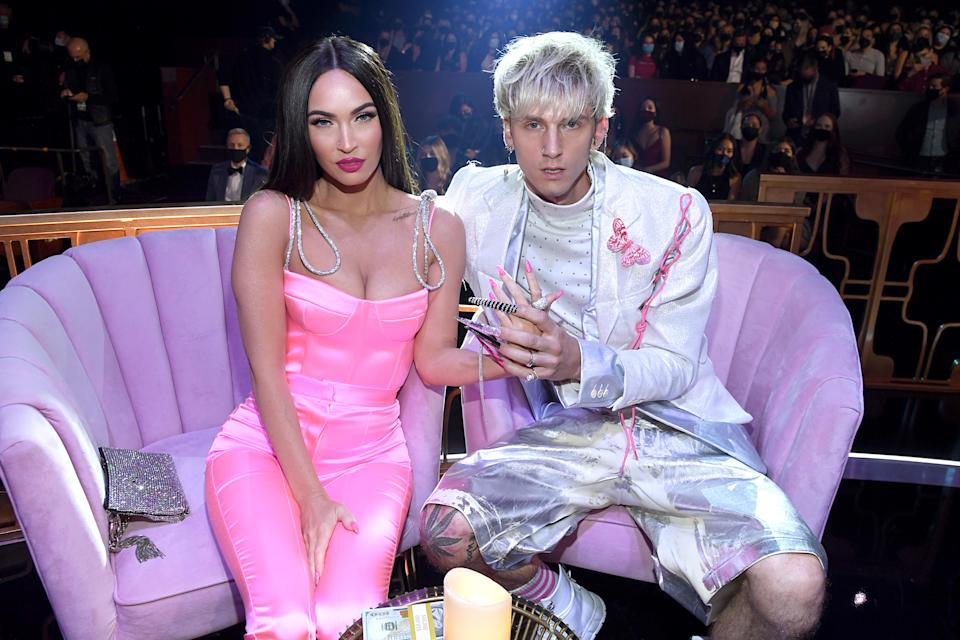 LOS ANGELES, CALIFORNIA - MAY 27: (EDITORIAL USE ONLY) (L-R) Megan Fox and Machine Gun Kelly attend the 2021 iHeartRadio Music Awards at The Dolby Theatre in Los Angeles, California, which was broadcast live on FOX on May 27, 2021. (Photo by Kevin Mazur/Getty Images for iHeartMedia)
